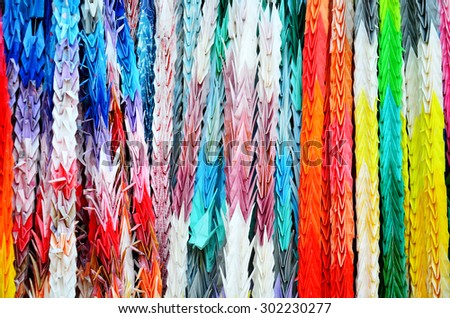 Traditional Japanese Thousand origami cranes for japan call Senbazuru pray with god for instead of just one wish, such as long life or recovery from illness or injury at Fushimi Inari taisha shrine - stock photo