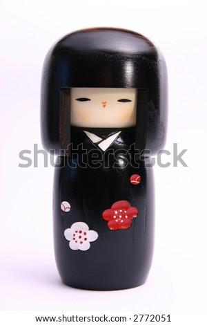Traditional Japanese wooden souvenir doll, Kokeshi chan. - stock photo