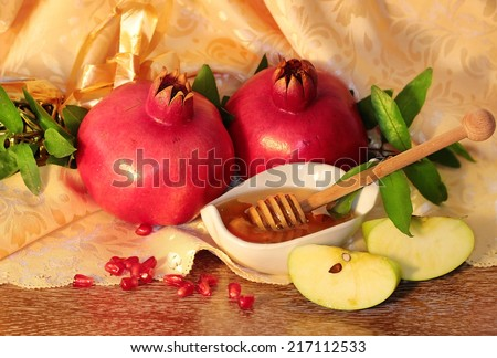 traditional jewish food, honey, apples and pomegranate for the holiday of Rosh Hashanah - stock photo