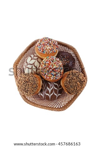 traditional jewish holiday chanuka donuts covered by dark chocolate on retro vintage basket isolated on white background - stock photo