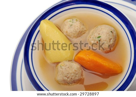 Traditional Jewish matzah ball soup, dumplings made from matzah meal - ground matzo. Over white, room for copy - stock photo