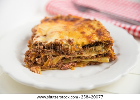 traditional lasagna made with minced beef bolognese - stock photo