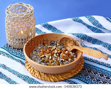 Traditional lean porridge from a wheat, poppy, nuts and honey, which is cooking in eve Christmas - stock photo