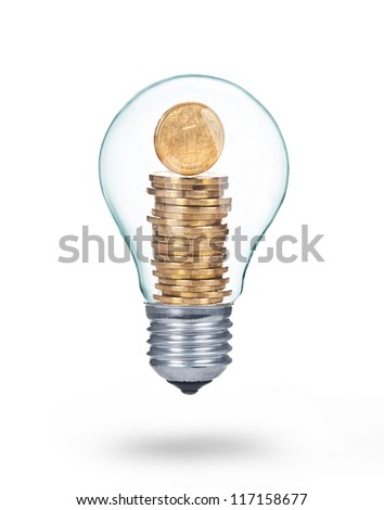 Traditional light glass bulb with golden coins isolated on white - stock photo