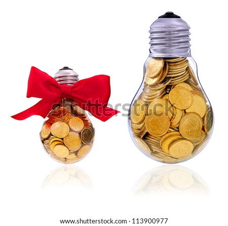 Traditional light glass bulb with many golden coins - stock photo