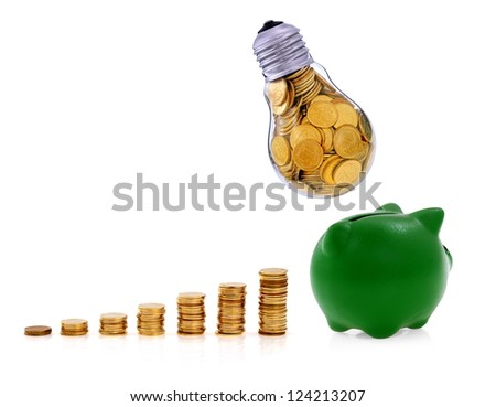 Traditional  lightbulb with  golden coins and green piggy bank, creative business symbols - stock photo