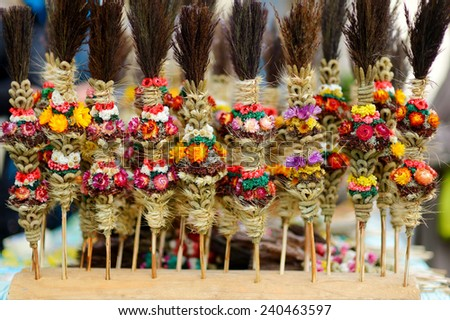 Traditional lithuanian Easter decorative palm bouquets sold on spring market - stock photo