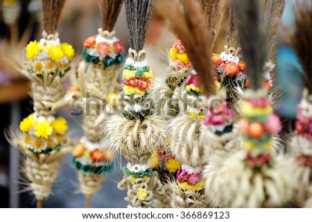 Traditional Lithuanian Easter palm known as verbos sold on spring market in Vilnius, Lithuania - stock photo