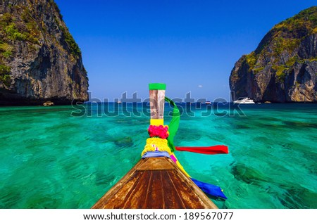 Traditional longtail boat in Maya bay on Koh Phi Phi Leh Island, Thailand - stock photo
