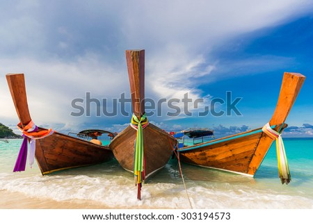 Traditional longtail boats in the famous Lipe island, Satun province, Thailand - stock photo