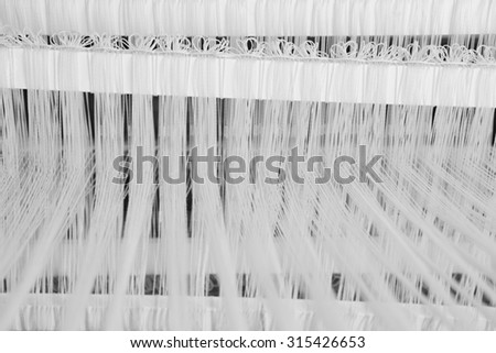 Traditional loom detail with wool yarn in black and white. Horizontal - stock photo