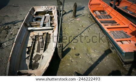 Traditional Malay fishing boats dock side by side at the fisherman's wharf after return from sea. This island is famous for sea food products and restaurants. - stock photo