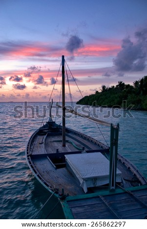 traditional maldivian Dhoni in the Sunset, Maldive Islands - stock photo