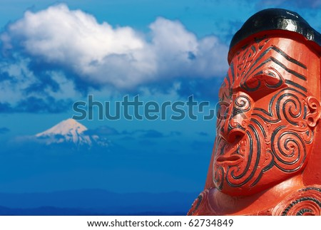 Traditional maori carving over Taranaki Mount background, New Zealand - stock photo