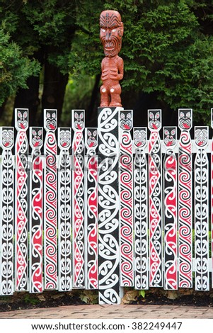 Traditional Maori carving sculpture of a man in Rotorua park, North Island, New Zealand - stock photo