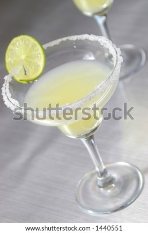Traditional margarita over a stainless steel bar. - stock photo
