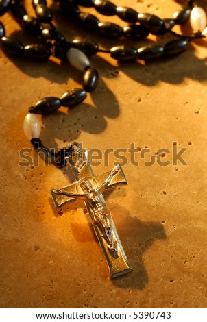Traditional Metal Crucifix Rosaries Beads On A Stone Background - stock photo