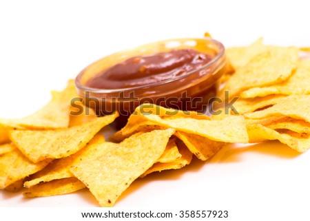Traditional mexican nachos with tomato sauce on white - stock photo