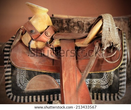 Traditional mexican saddle prepared for horse riding - stock photo