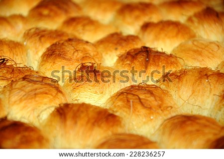 Traditional Middle Eastern dessert pastry made with a special form of shredded fillo dough which is also called kataifi - stock photo