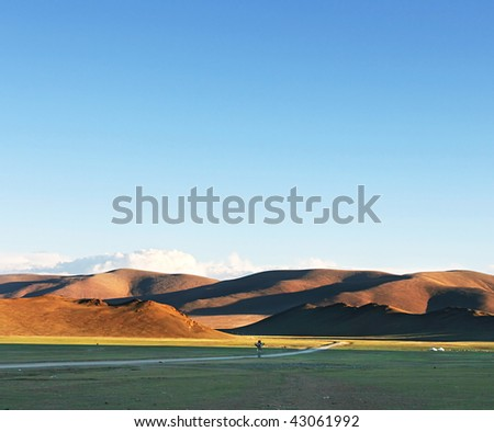 Traditional Mongolian landscape in the sunset - stock photo
