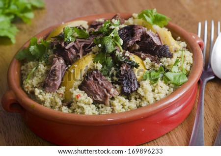 Traditional Moroccan beef tagine with couscous - stock photo