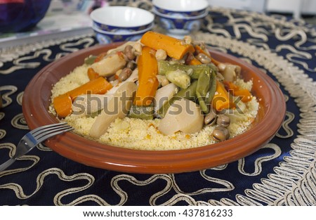 Traditional moroccan tajine with couscous and vegetables on the table. - stock photo