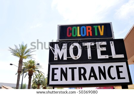 "Traditional ""Motel"" entrance sign from an era when a color TV was still a luxury - stock photo"