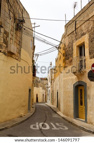 Traditional narrow street in Gozo. Maltese architecture in Rabat, Malta - stock photo