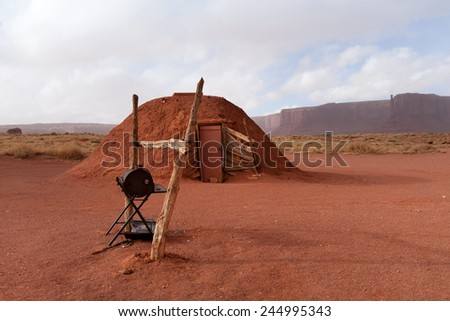 Traditional Navajo hogan in Monument Valley, USA - stock photo
