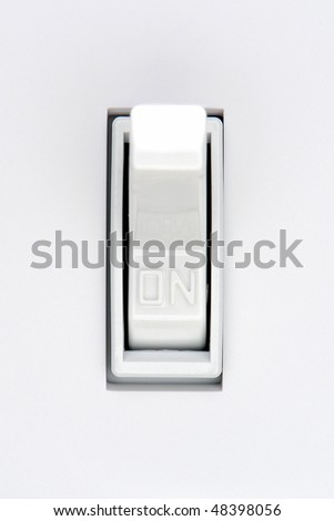 Traditional North American toggle electric light switch in ON position - stock photo