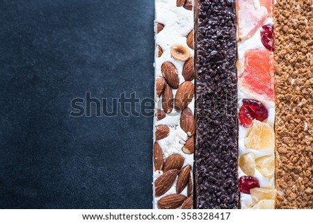 Traditional nougat bars on dark slate background, with copy space - stock photo