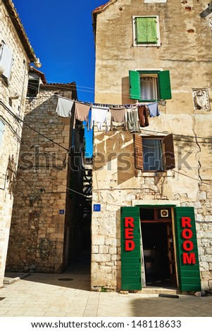 Traditional old house on the street of Split with open green door - stock photo