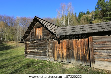 traditional old ukrainian wooden house in Carpathian - stock photo