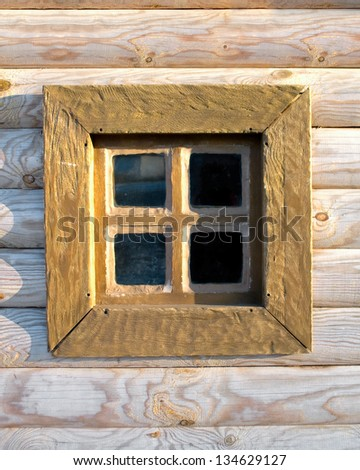 Traditional old window on the wooden wall in russian country house - stock photo