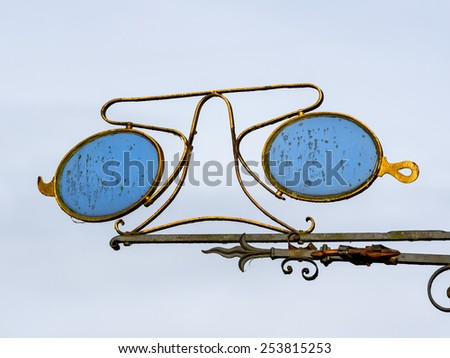 Traditional opticians sign in Ribe in Denmark - stock photo