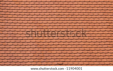 Traditional orange tiles of a newly built house - stock photo