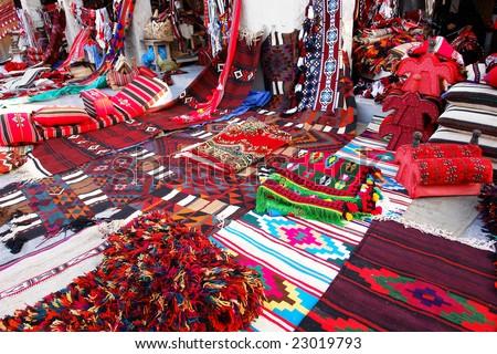Traditional oriental carpets in Wakif souk in Doha Qatar - stock photo