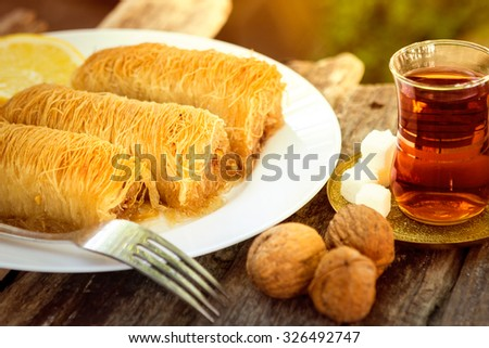 Traditional oriental dessert with syrup - stock photo