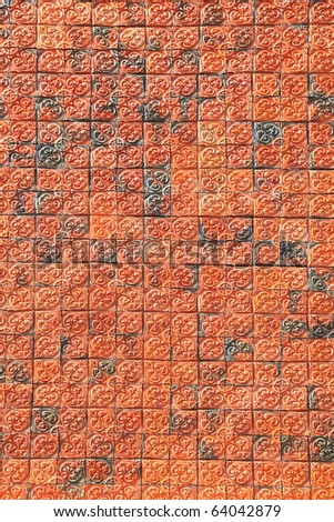 Traditional ornamental red brick wall - stock photo