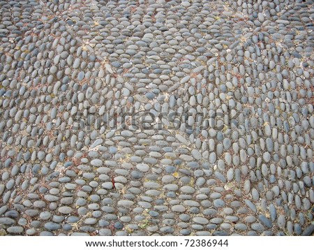 Traditional ornaments made of paving stones - stock photo