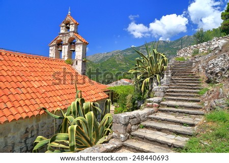Traditional orthodox church surrounded by Mediterranean vegetation, Montenegro - stock photo