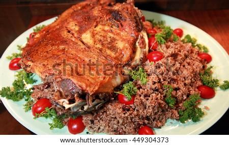 Traditional Ottoman food 'Lamb with Rice' (Turkish: Kuzu Kapama) on the dinner plate. - stock photo