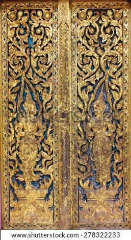 Traditional pattern Thai style of old temple door in temple - stock photo