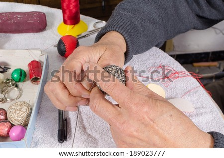 Traditional pelota in production at the hands of an expert artisan - stock photo