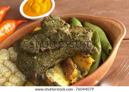 Traditional Peruvian food called Pachamanca which is from the Andean region, It consists of meat with herbs, potato, corn and broad beans (Selective Focus, Focus on the meat) - stock photo