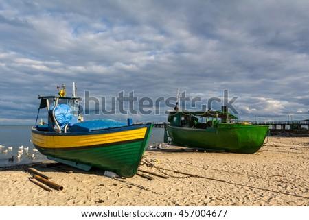 Traditional Polish fishing boats in Gdynia. Sea beach in Orlowo. Poland - stock photo
