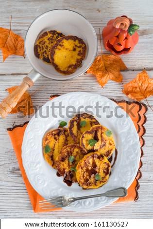 traditional Polish pumpkin yeast pancakes (Racuchy) - stock photo