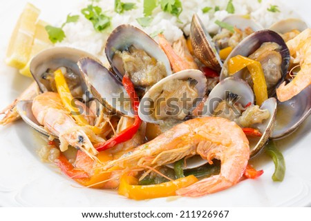 Traditional portuguese seafood dish - cataplana-The cooking process used by the CATAPLANA prevents the loss of the ingredients' aromas, ensuring full and excellent flavor. - stock photo