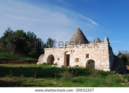 Traditional Pugliese Stone Trullo Country House in the Characteristic Architecture of the Valle d�Itria, Which is Unique in the World, Near Martina Franca, Valle d�Itria, Italy - stock photo